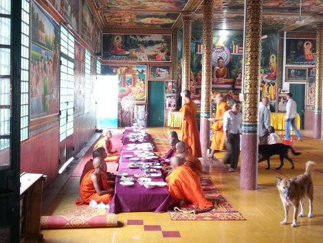 Monks at Wat Leu receiving alms